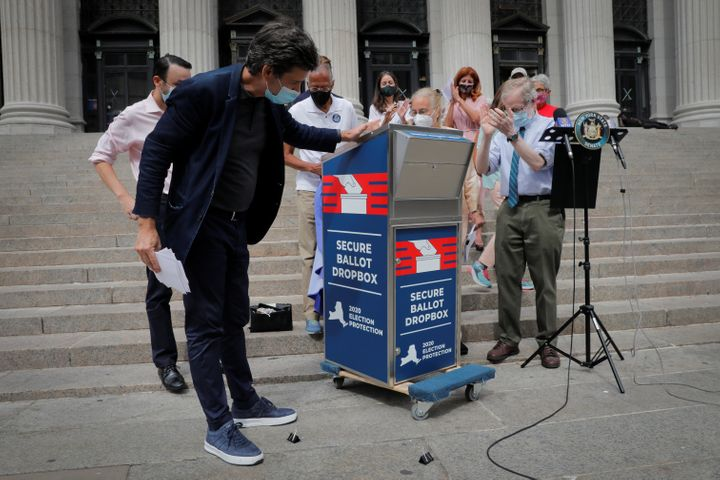 New York State Sen. Brad Hoylman (left) unveils a secure ballot drop box along with other local leaders on Aug. 31 as they ra