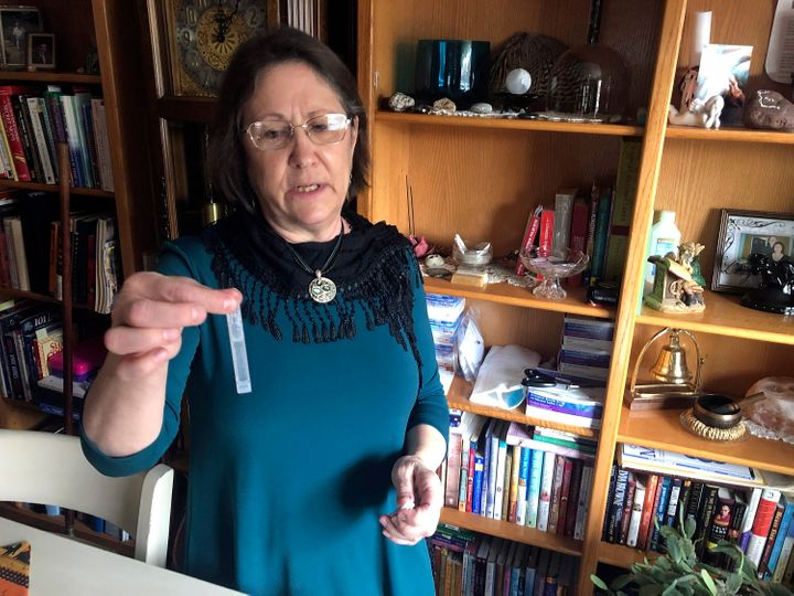 Barbara Trout, who has an asthma disorder, holds a vial of inhalation solution of Ipratropium Bromide and Albuterol Sulfate,