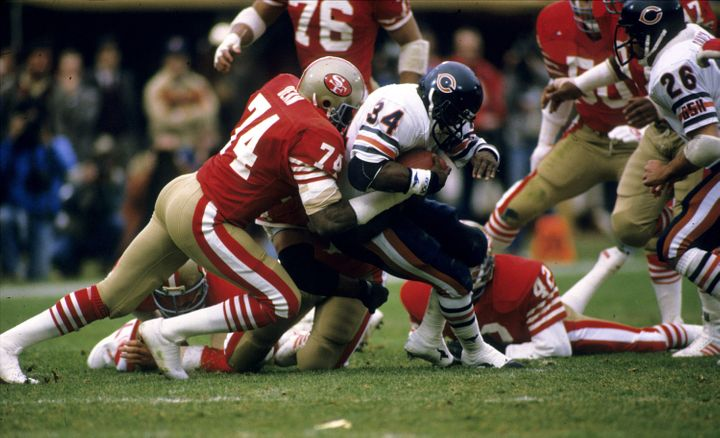 Fred Dean tackles future fellow Hall of Famer Walter Payton in the 1984 NFC Championship Game.