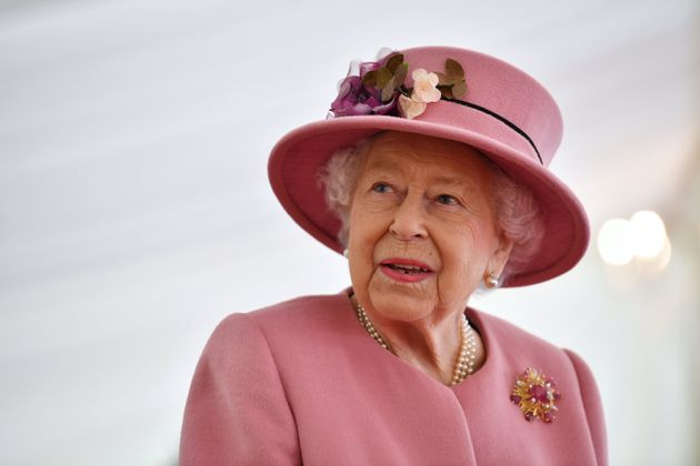 Queen Elizabeth speaks with staff during the