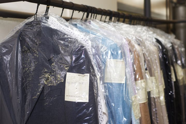 The chemicals used in dry cleaning don't kill viruses, but the heat applied during pressing and ironing can.