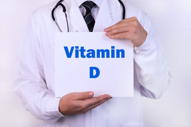 Doctor holds a sign of Vitamin D, medical concept.
