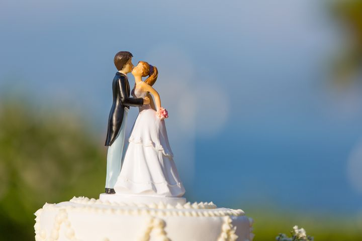 white wedding cake with topper