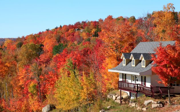 A villa sits on a hillside near Mont Tremblant, Que., in this undated file photo. The average house price...