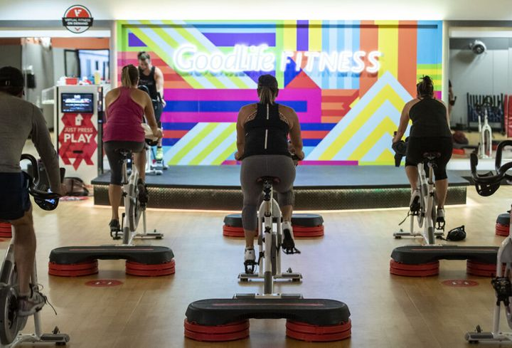 People participate in a spin class at a GoodLife location in Ottawa on July 17. Gyms have been forced to close in parts of Ontario since reopening, but experts say it's better to give people options than to ban activities entirely.
