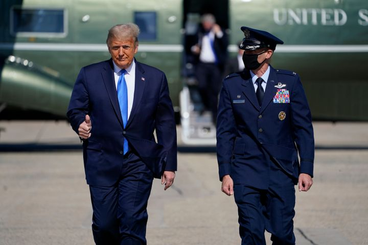 President Donald Trump gives a thumbs-up as he walks to board Air Force One at Andrews Air Force Base in Maryland for a trip