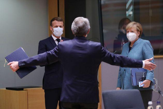 European Parliament President David-Maria Sassoli (C) greets Germany's Chancellor Angela Merkel (R) and...