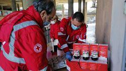 Da un giorno all'altro in coda per il pacco della Croce Rossa (di G.