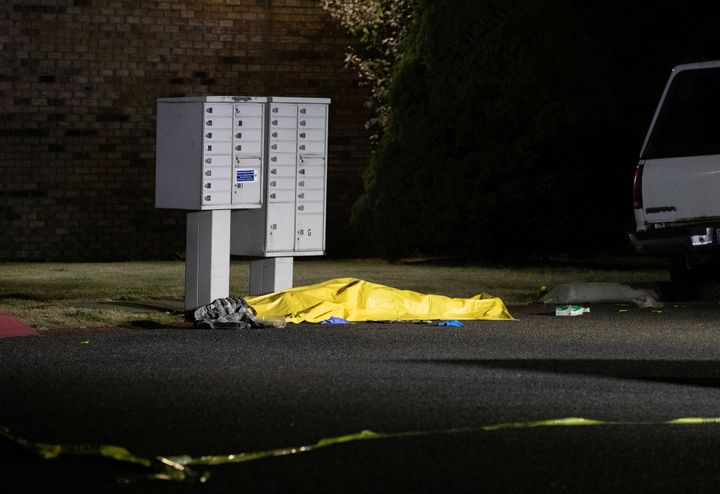 A tarpaulin covering the body of a man who is reportedly Michael Forest Reinoehl is seen after he was shot and killed by law