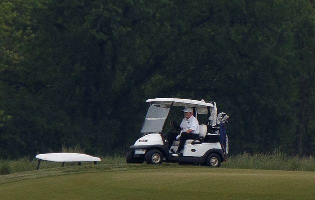 Amid the coronavirus pandemic, President Donald Trump takes a break at the Trump National Golf Course...