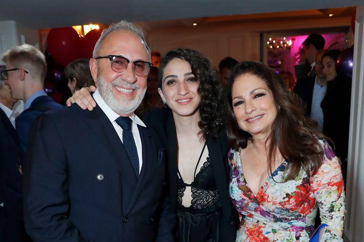 Emily Estefan (middle) with her parents, Emilioand Gloria Estefan.