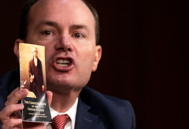 Sen. Mike Lee (R-Utah) holds up a copy of the U.S. Constitution during the Supreme Court confirmation...