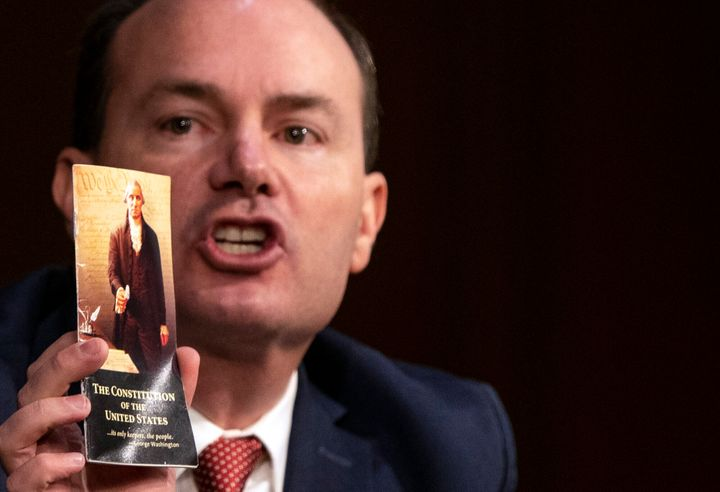Sen. Mike Lee (R-Utah) holds up a copy of the U.S. Constitution during the Supreme Court confirmation hearing for Judge Amy Coney Barrett on Monday.