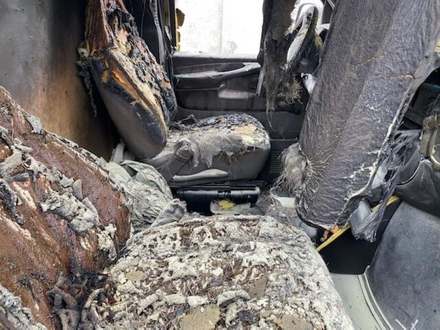 The interior of Jason Marr's damaged van is seen after it was engulfed in flames outside a lobster facility...