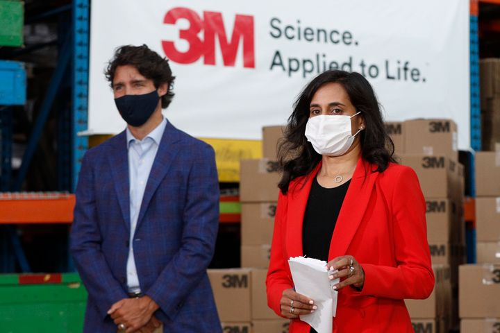 Minister of Public Services and Procurement Anita Anand and Prime Minister Justin Trudeau wear a mask during an announcement at the 3M plant in Brockville, Ont. on Aug 21, 2020.