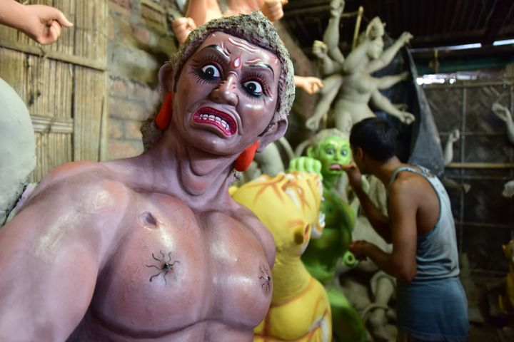 An artist finishing Asura where Durga idols are being prepared ahead of Durga puja in Nagaon District of Assam, October 9, 2020.