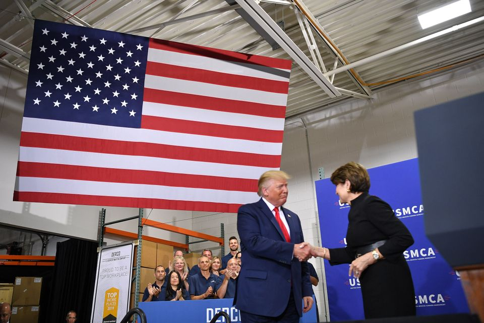President Donald Trump greets then-Lockheed Martin CEO Marillyn Hewson at the Derco Aerospace Inc. plant...