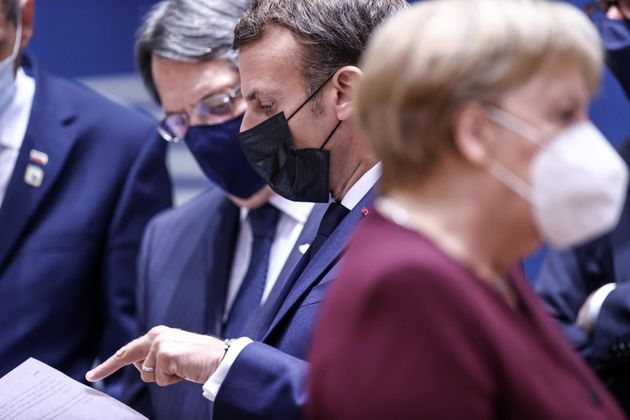 epa08749675 France's President Emmanuel Macron (C), Cyprus' President Nicos Anastasiades (L) and Germany's...