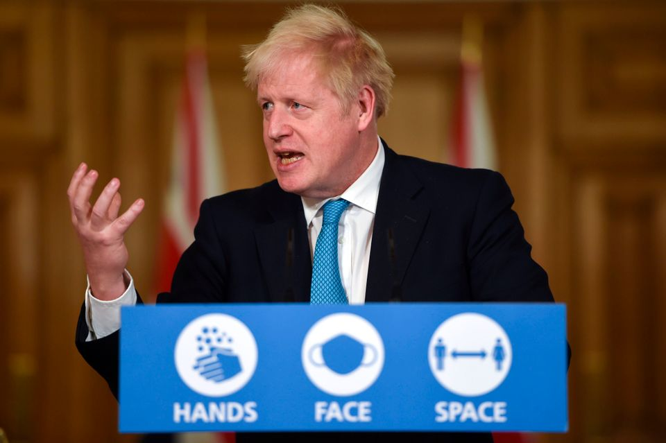 Boris Johnson speaks during a press conference ahead of the imposition of tighter restrictions in some...