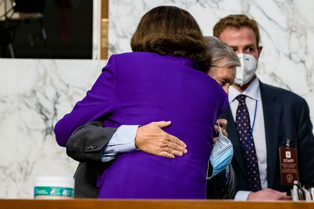 Sen. Dianne Feinstein (D-Calif.) hugs Sen. Lindsey Graham (R-S.C.) as the confirmation hearings for Supreme...