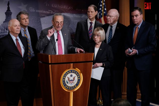 Senate Minority Leader Chuck Schumer (D-N.Y.) and fellow Democrats hold a news conference March 11 to...