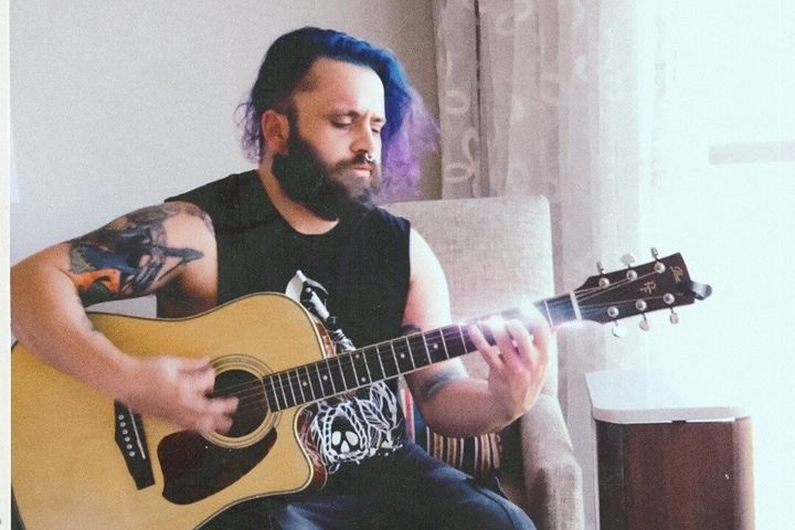 Justin Coffman, the bassist in a punk rock band, is facing felony charges after posting images from an album photo shoot.