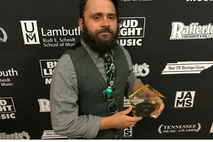 Justin Coffman with his award as bassist of the year in Tennessee.