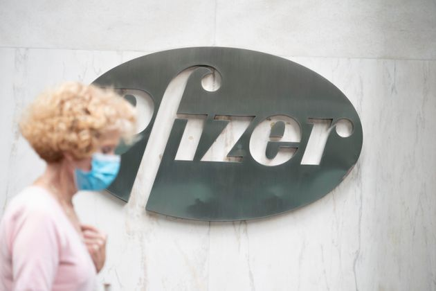 Photo by: John Nacion/STAR MAX/IPx 2020 A view of people passing by Pfizer logo at their New York Headquarters...