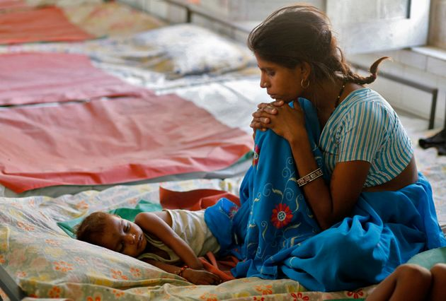 A mother looks at her malnourished child in the Nutritional Rehabilitation Centre of Sheopur district...