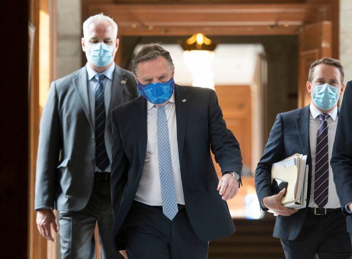 Quebec Premier Francois Legault walks to question period on Oct. 6, 2020.