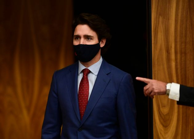 Prime Minister Justin Trudeau makes his way to a press conference during the COVID pandemic in Ottawa...