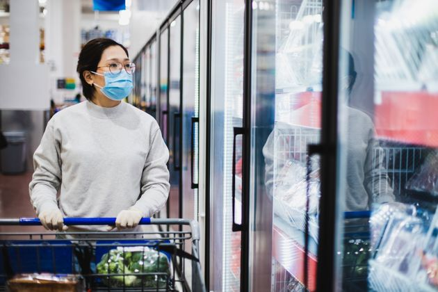 Asian female wearing a face mask shopping at the