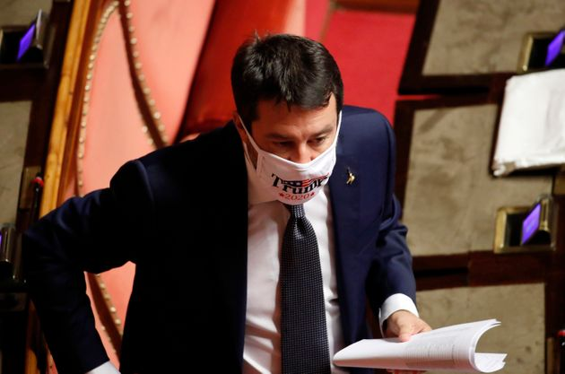 Italian senator Matteo Salvini wears a protective mask in support of Donald Trump in the Senate Chamber...