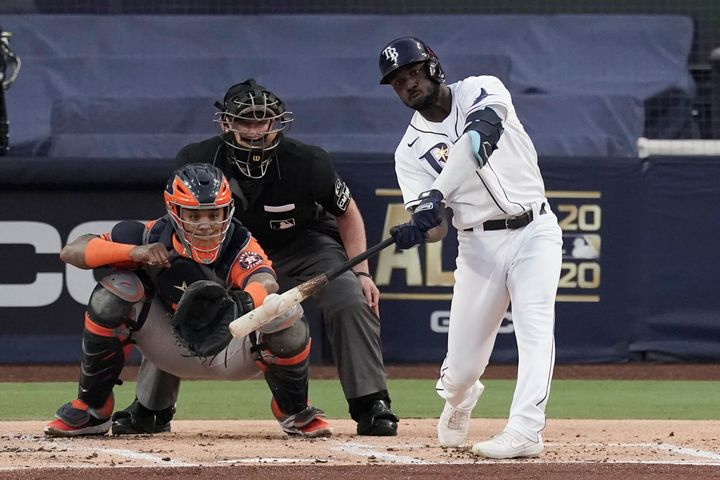 Tampa Bay Rays Randy Arozarena hits a two run home run against the Houston Astros during the first inning in Game 7 of a base