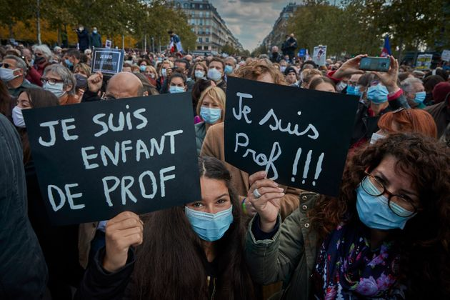 PARIS, FRANCE - OCTOBER 18: Protestors hold 'Je Suis Prof' placards during an anti-terrorism vigil at...