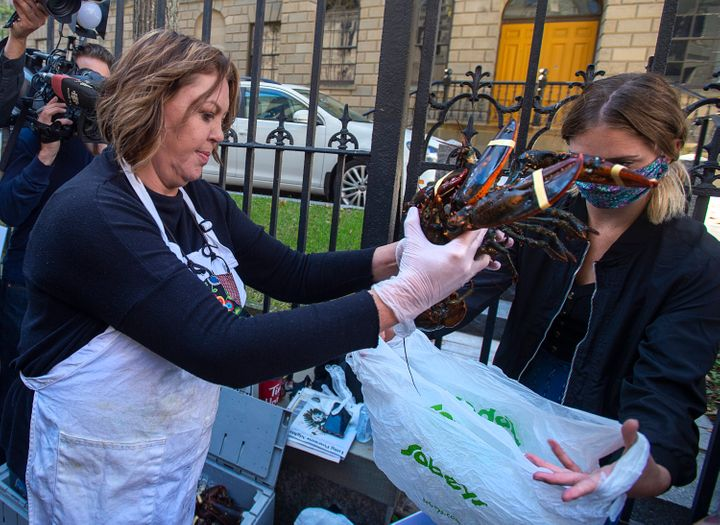 Cheryl Maloney sells lobster outside the legislature in Halifax on Friday.