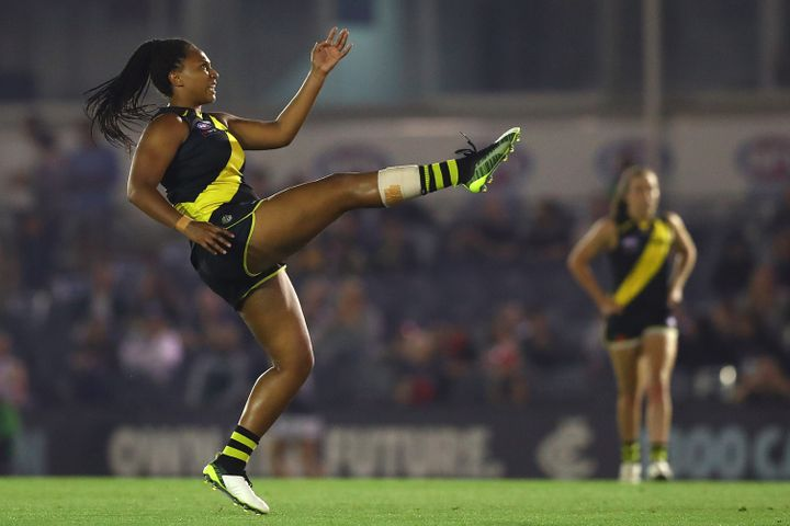 Sabrina Frederick of the Tigers kicks a goal during the round one AFLW match between the Richmond Tigers and the Carlton Blues at Ikon Park on February 07, 2020 in Melbourne.