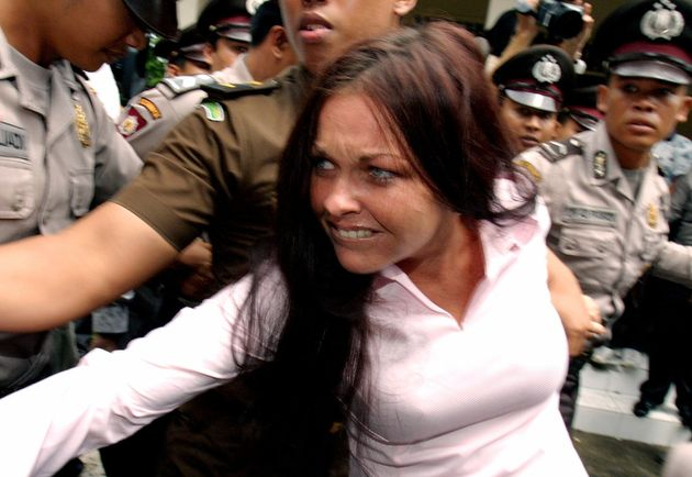 Australian Schapelle Corby, then 27, being escorted by Indonesian police from a court in Denpasar on...