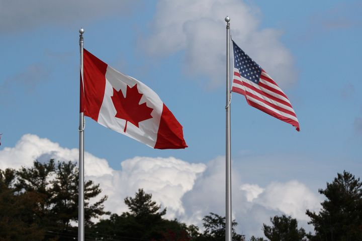 A Canadian and U.S. flag fly at a border crossing in Lansdowne, Ont., on Sept. 28. The border has been closed to control the spread of the novel coronavirus.