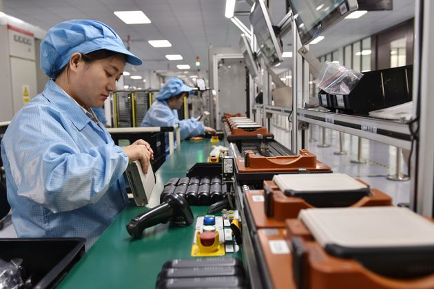 NANJING, CHINA - OCTOBER 19, 2020 - A worker automates the production of an intelligent control unit....