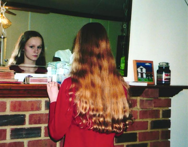 """The author documenting hair as her """"glory"""" before a haircut in 2004."""