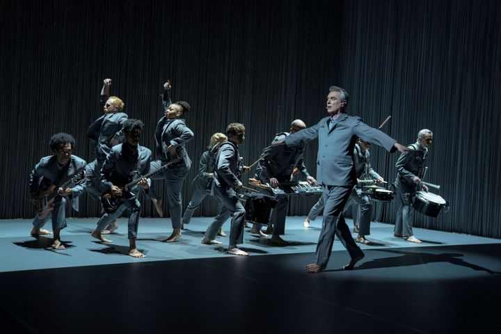 David Byrne and his band, withGiarmo and Kuumba dancing in the background.