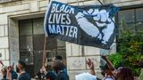 LOUISVILLE, KY - OCTOBER 13: Black Lives Matter protesters march in the street to the KFC YUM! Center for early voting on October 13, 2020 in Louisville, Kentucky. Tuesday marked the first day of early in-person voting in Kentucky, which lasts through November 2. (Photo by Jon Cherry/Getty Images)