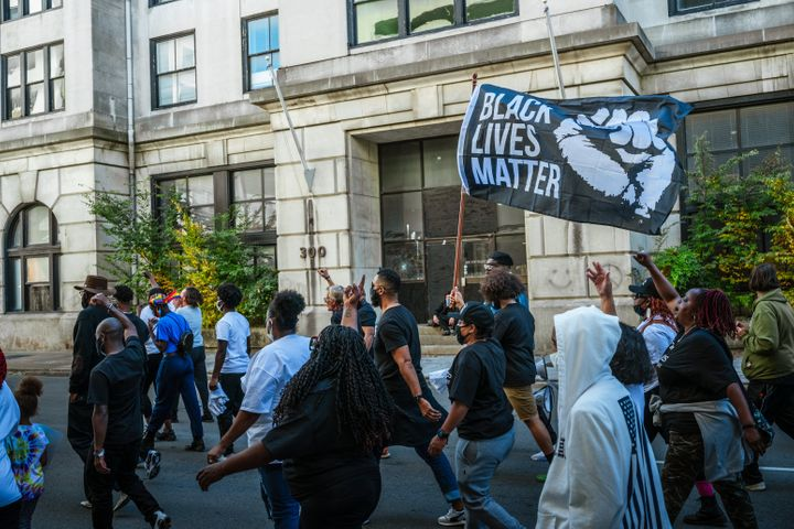 Black Lives Matter protesters march in the street before participating in early voting on October 13 in Louisville, Kentucky.
