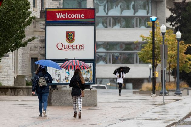 Students walk on a rainy day the Queen's University campus in Kingston, Ont., on Monday. A months-long...