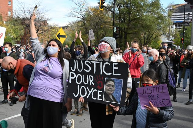 Protesters gather during a demonstration in central Montreal on October 3, 2020, to demand action for...