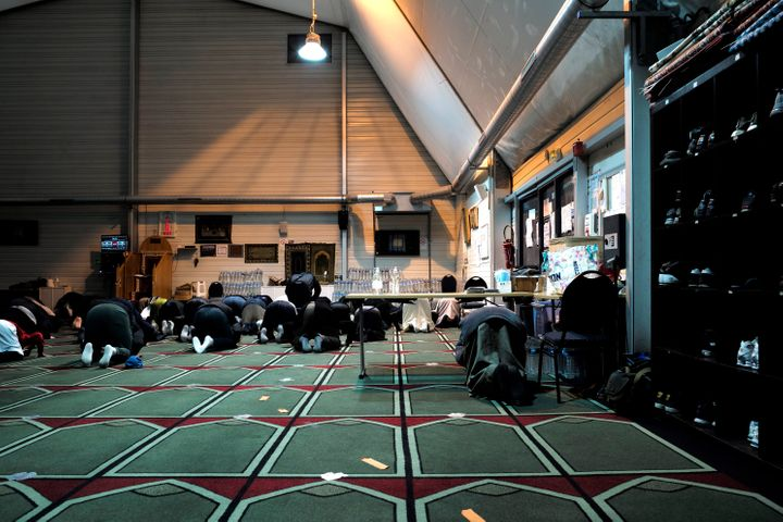 Muslim faithful pray inside the Pantin mosque on Tuesday. Since the attack, operations targeting structures or people suspect