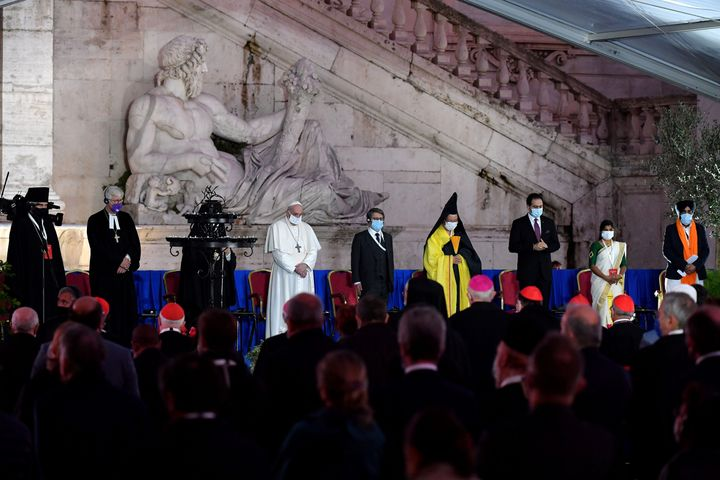 Pope Francis stands with representatives from various religions during an interfaith ceremony for peace in Rome on October 20
