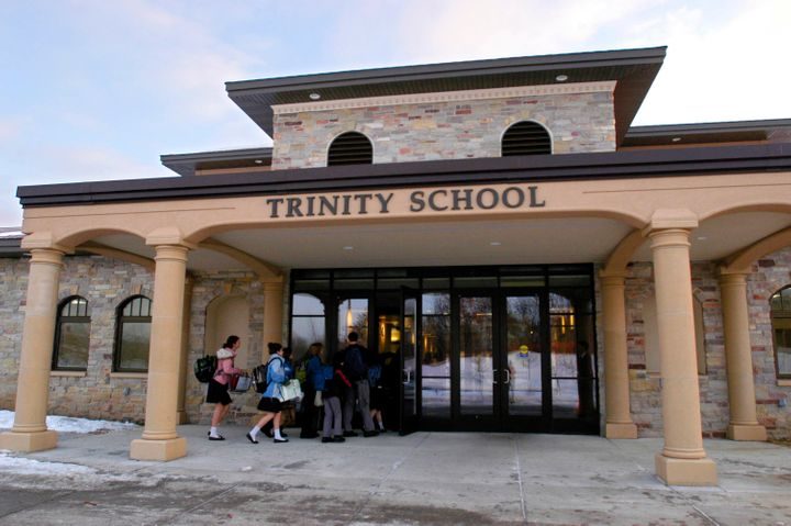 Students head into class for the first time on Jan. 14, 2008 at Trinity School at River Ridge's campus in Eagan, Minn.