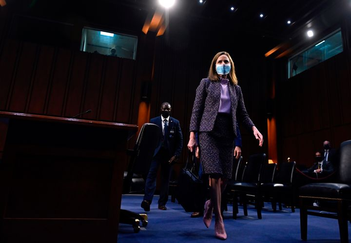 Supreme Court nominee Judge Amy Coney Barrett leaves after testifying on the third day of her confirmation hearing before the
